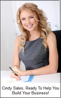 business woman at desk smiling